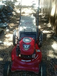 red and black Craftsman push lawn mower