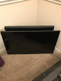 Black flat screen tv with remote Saint Charles, 63303