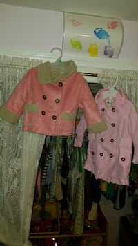 two pink double breasted coats