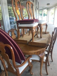 Dining room table with eight chairs to arm six are your two leaves and table covers Howell, 07731