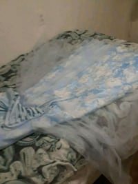 white and blue floral bed sheet