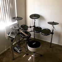 black and gray electric drum set
