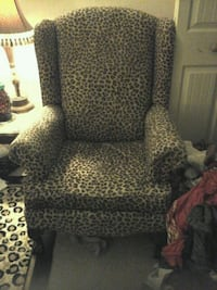 brown and black leopard print sofa chair
