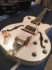 Hollow body guitar Pearl with orange inlay