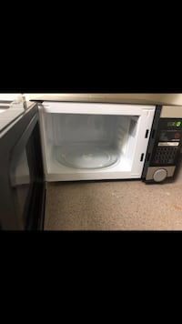 White and black microwave oven Orlando, 32839