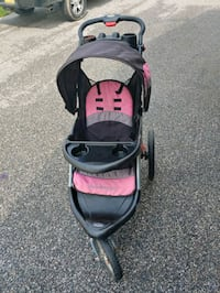 Pink grey and black jogging stroller with speakers