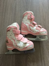 pair of pink-and-white inline skates Vancouver, V6G 2G3