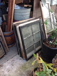Two black and one brown glass window panels Sebring, 33870