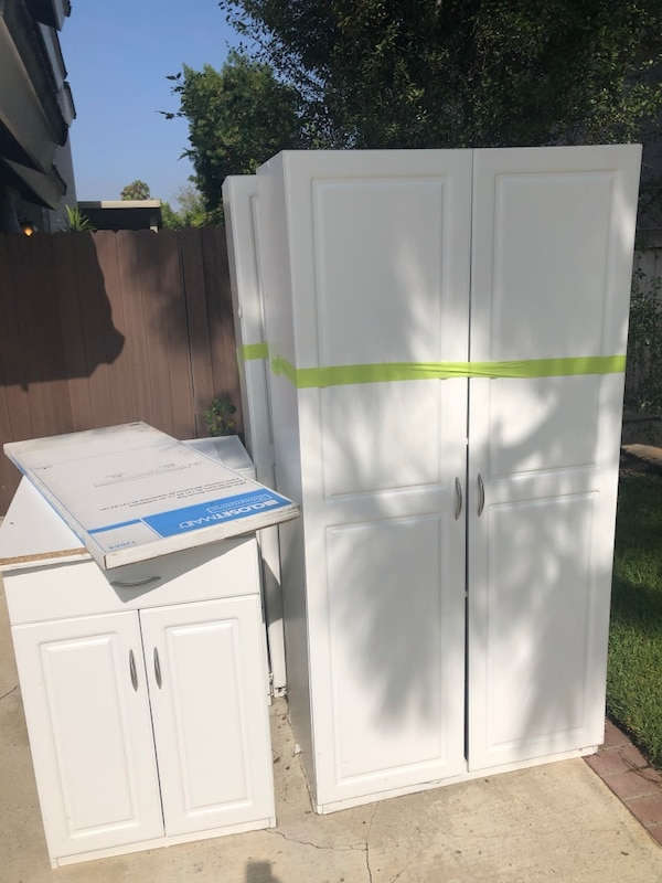 Used Kitchen or garage cabinets. 2 tall and 2 short w/ extra ...