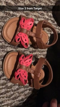 baby's pair of brown-and-pink sandals