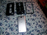 gray LG smartphone with three black cases