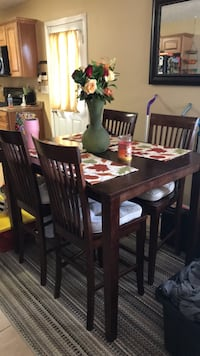 Rectangular brown wooden table with six chairs dining set McDonough, 30252