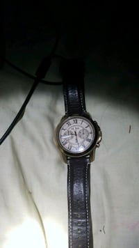 round silver-colored chronograph watch with black leather strap 153 mi