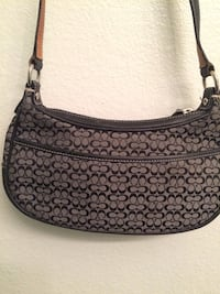Gray and black coach crossbody bag