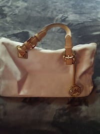 white and brown Michael Kors leather handbag