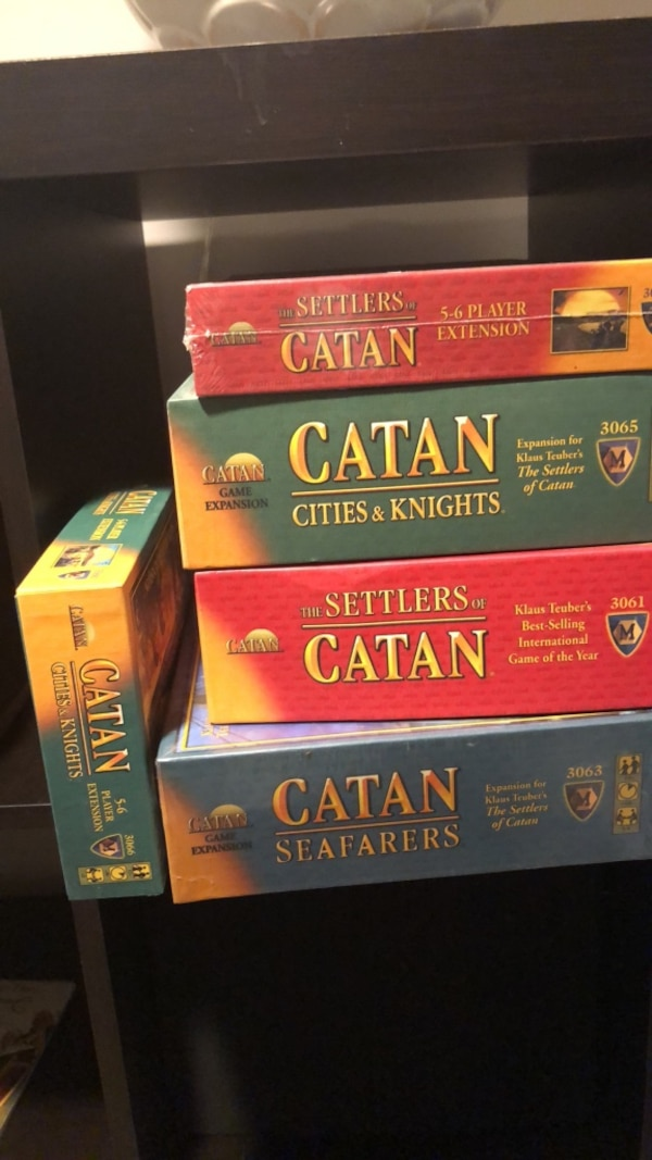 Games! Settlers of Catan!! Amazing game. Mostly unopened due to kids outgrowing. Under 12 will love!!