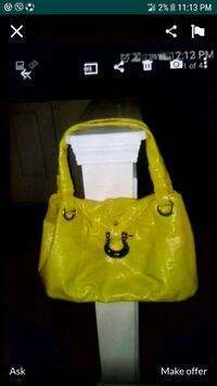 yellow purse great condition  Indian Trail, 28079