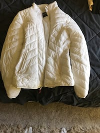 brown and white zip-up jacket