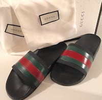 pair of black Gucci slide sandals