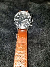 round black chronograph watch with brown leather s Calgary, T2B 0W4