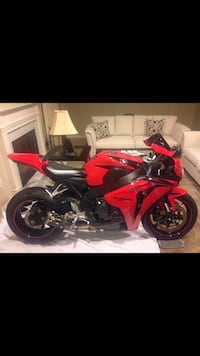 2009 Honda CBR 1000 RR, New rear tire, two brothers exhaust, Dyno Jet Power commander, OEM Honda racing solo seat & leather seat, 9500 miles, great condition, bike runs strong, Final price $7000.