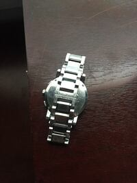 Round silver-colored analog watch with link bracelet 875 mi