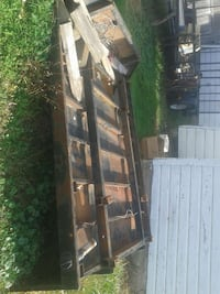 black and brown wooden bed frame 148 mi