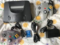 N64 system, 2 controllers, memory card, game storage case & 14 games East Providence, 02916