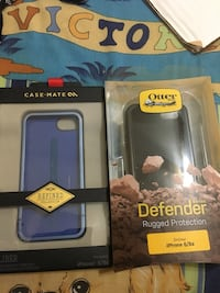 two Otterbox and Casemate iPhone case boxes