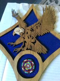 brown wooden eagle wall decor
