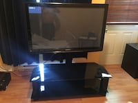 black flat screen TV with open-shelving TV stand