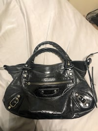 Authentic vintage Balenciaga city bag. Missing long strap but easily replaceable. Missing pull for zipper on front pocket. Great for if you have time to fix her up! Milton, L9T 8L6