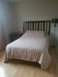 white bed sheet with brown wooden bed frame Laval, H7P 0B6