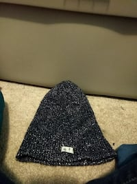 gray and black knit cap