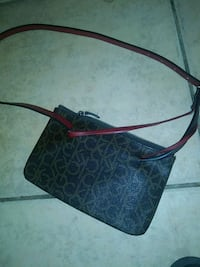 black and red monogrammed Coach leather crossbody bag Cathedral City, 92234