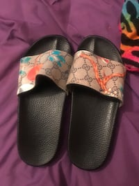 pair of black-and-white slide sandals 874 mi