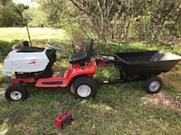 red and black ride-on mower 1338 mi