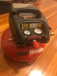 black and red Central Pneumatic air compressor Boston, 02125