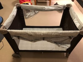 Eddie Bauer pack and play with bassinet and canopy