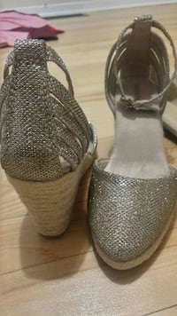 pair of gray wedge sandals