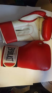 pair of red-and-white Everlast boxing gloves