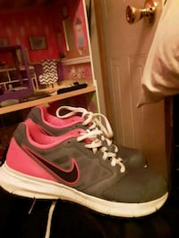 pair of black-and-pink Nike running shoes Opelousas, 70570