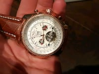 round silver-colored chronograph watch with brown leather strap Vaughan, L4J 8R7