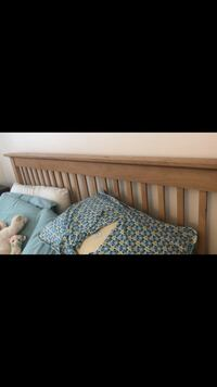 California king bed with mattress, headboard, footboard and bedding