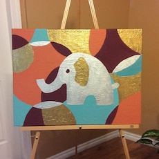 gray elephant with assorted color painting