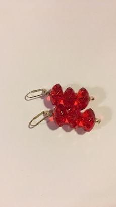 two gold and ruby earrings