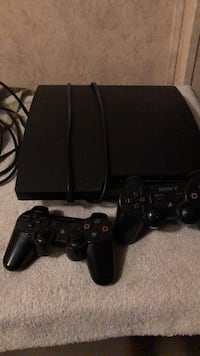 black Sony PS3 slim console with two controllers Alpine, 35014