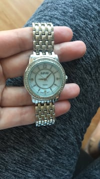 round silver-colored analog watch with link bracelet Chicago, 60605