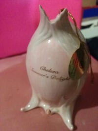 white and pink ceramic ornament