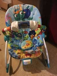 Musical vibrating baby bouncer
